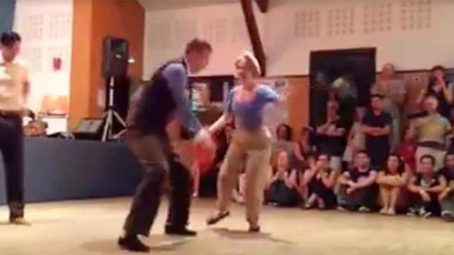 He grabbed her hand to dance – but now watch the man in the white