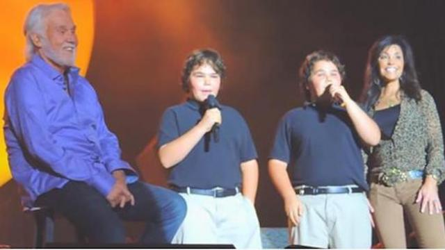 Kenny Rogers watches with pride as his twin sons join him on stage for a song