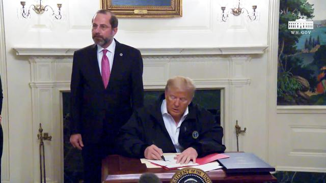 President Trump signs a bill on the coronavirus