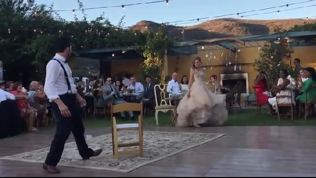 Groom collapses back and freezes when bride steps away during 'magical' first dance