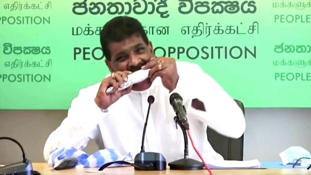 Sri Lanka's former minister eats raw fish