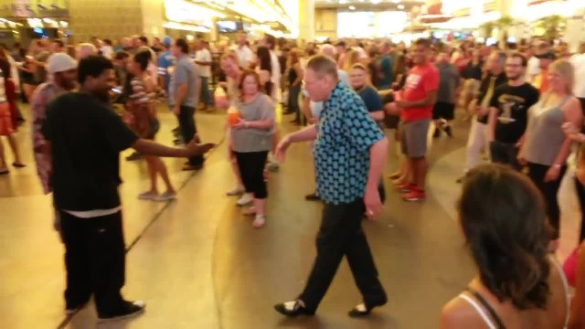 Grandpa challenges these two performers to a dance-off competition