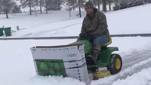 Man uses recycled TV box and lawn mower to make the most creative snow plow we've ever seen