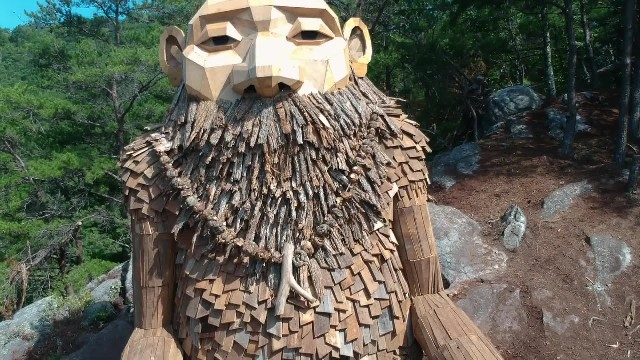 Artist creates massive sculptures and nestles them into hidden spots in Copenhagen forests