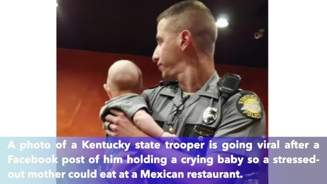 Kentucky state trooper holds crying baby so his mother could finish her meal