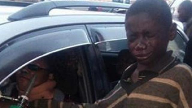 Homeless Boy Approaches Car To Beg For Change – But When He Peeks Inside, He Bursts Into Tears