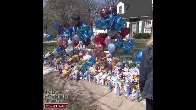 "WATCH: Teddy bears, candles and balloons line the sidewalk outside of Andrew ""AJ"" Freund's home Thur"