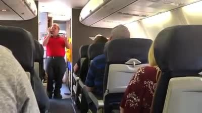 Southwest Airlines employee sings 'You Raise Me Up' to mother of fallen state trooper