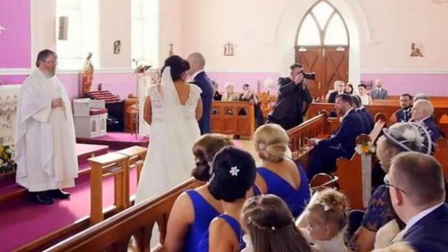 Her wedding ceremony was interrupted by a voice in the back, leaving this bride in tears all day