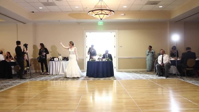 Bride and father surprise guests with awesome daddy daughter dance