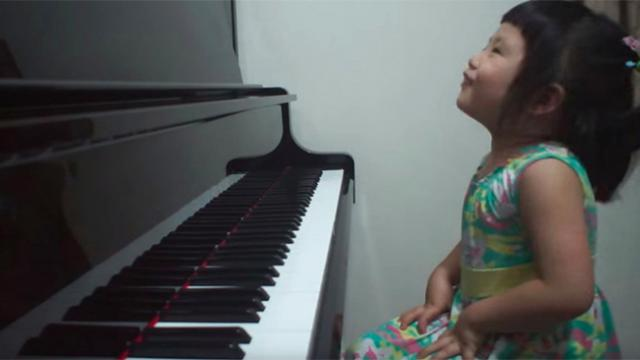 Adorable 3-year-old giggles at piano and within moments blows