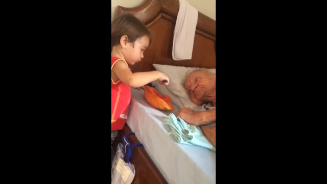 Boy feeds his grandpa in the mouth and moves the world