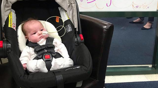 Mom helps baby ring bell after beating brain cancer- 'They say it's magic. I say it's faith'