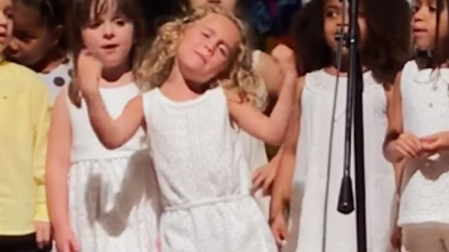 Preschoolers line up for music show, keep your eyes on tiny blonde girl in the middle
