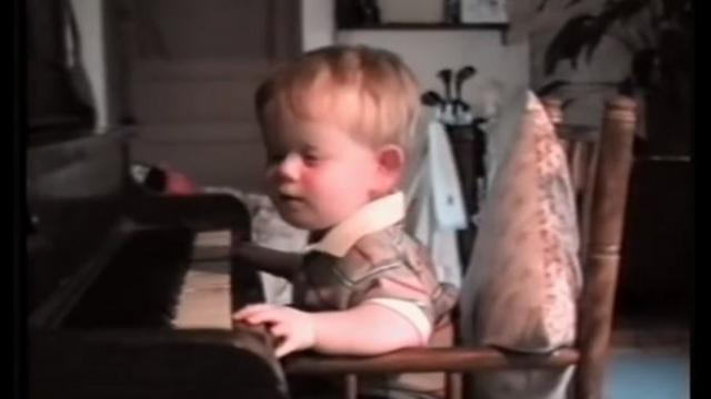 Baby born with no eyes sits at piano, his next move has dad running for a camera