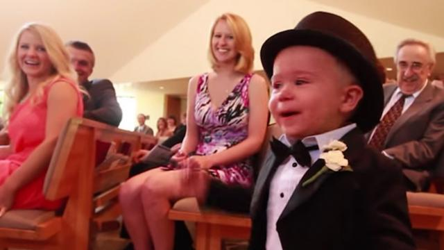 Usually the bride gets all the attention, but this ring bearer's entrance stole the show