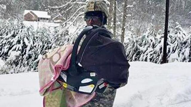 Photo of National Guard carrying sick baby to safety in North Carolina snowstorm wins hearts