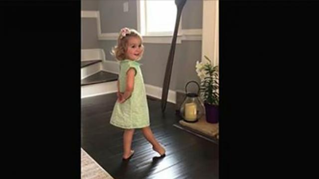 Toddler stands with hands behind her back, music starts – then
