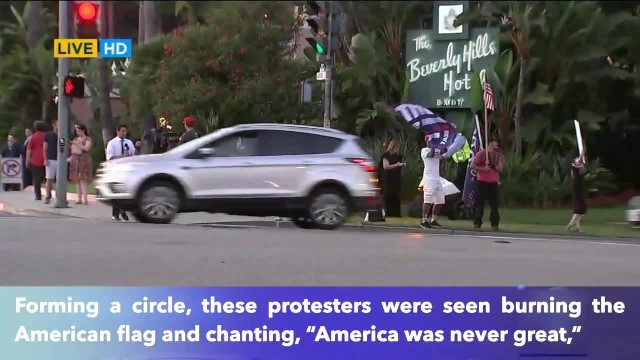 Anti-Trump Communist group burns the American flag, chant 'America was never great'