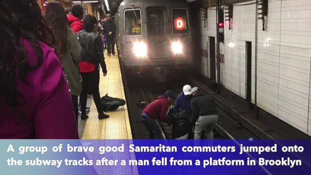 Commuters jump onto NYC subway tracks to rescue passed out man nearly struck by train