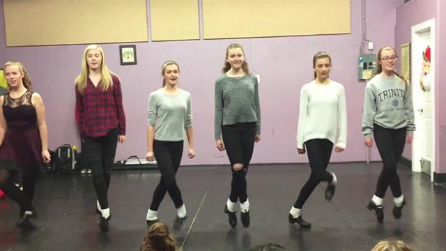 Six dancers hold hands on stage but when their feet start moving their clogging routine takes intern