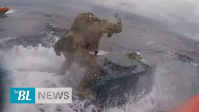 Dramatic footage of Coast Guard seizing alleged Drug Sub in Pacific
