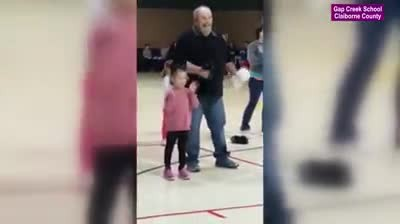 Nervous girl asks grandpa to cheer with her at competition busting out moves making crowd roar