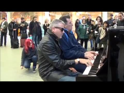 2 men play 'Boogie Woogie Jam' on public piano - then woman joins in and performance goes viral