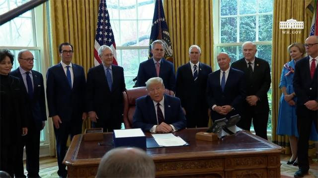 President Trump participates in a signing ceremony for H.R. 748, the cares act