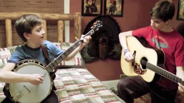 2 brothers are duelling on banjo and guitar. Moments later, another joins in and steals show.