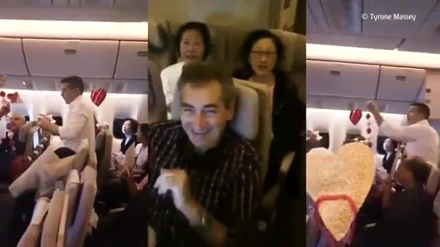 Passengers on plane help man propose to his flight attendant girlfriend