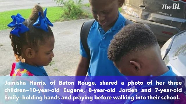 Siblings hold hands in a back-to-school prayer- 'We pray for everyone'