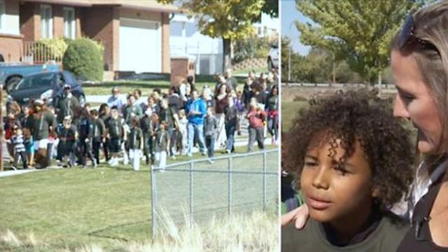 Boy is too scared to walk home from school when he looks out and sees a crowd of strangers waiting
