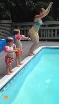 Child performs spectacular belly flop into pool and makes the whole family laugh
