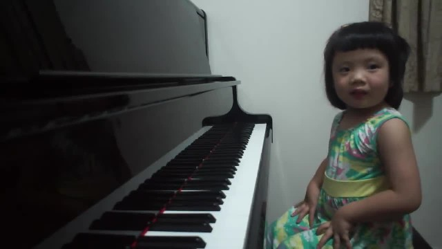 Adorable 3-year-old giggles at piano, moments later blows internet away with her talent