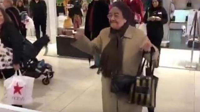 Grandma grooves to her favorite song at mall - crowd gathers to cheer on her smooth moves