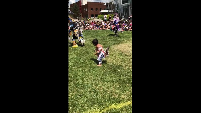 Adorable tiny native boy steals the show and upstages all the other dancers at first pow-wow