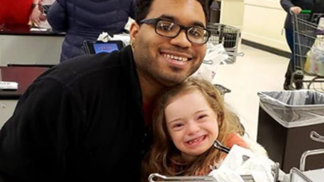 Little girl with special needs tells cashier 'I love you' after he lets her help bag groceries