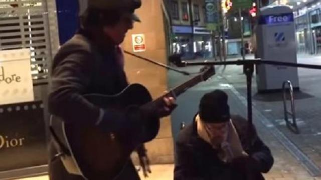 Homeless man asks to sing with street musician. The second he begins, onlookers stop dead in their t
