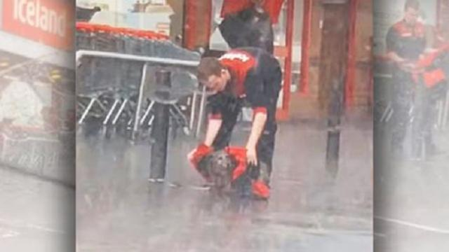 Viral video shows teen sharing his jacket with tied-up dog on rainy day