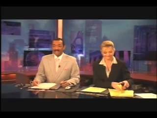 News anchors perform elaborate handshake during 2-minute commercial break