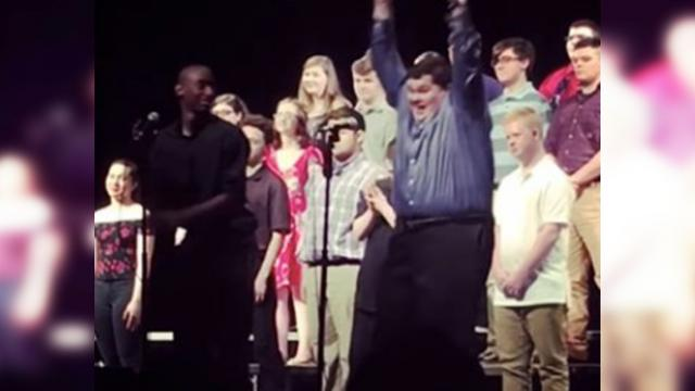Crowd cheers when teen with autism nails choir solo & his reaction is the cutest
