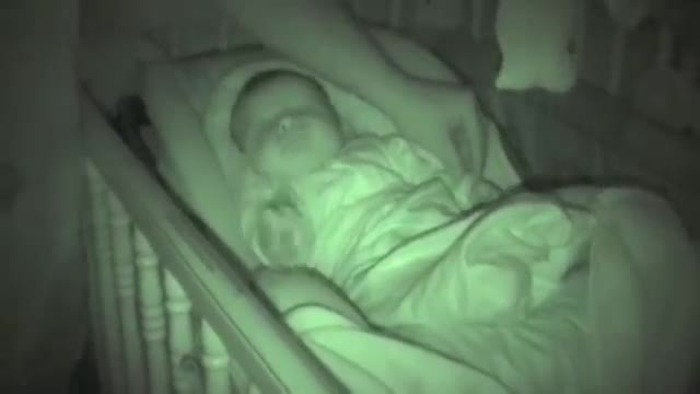 Dad put baby's cold hand back under the cover — But the nanny cam caught something so strange