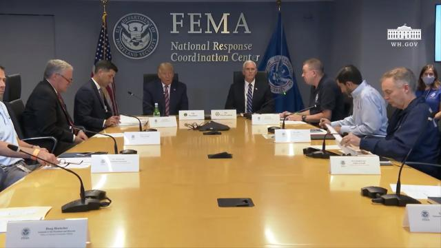 President Trump receives a briefing on hurricane Laura