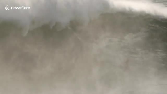 Intense rescue recorded as Jet skier pulls surfer from deadly waves moments before disaster
