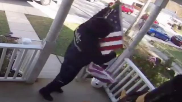 Fedex driver stops to fold American flag