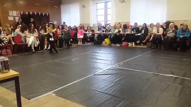 Boy is center of attention when he suddenly kicks up his feet stealing show in seconds