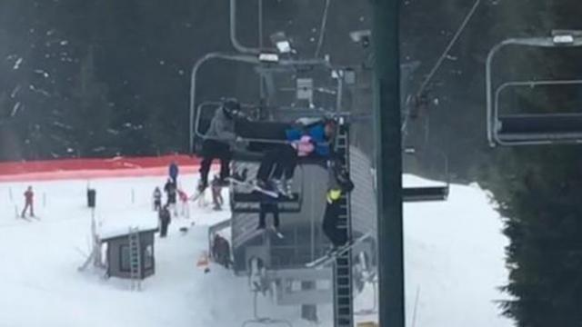 Group of kids save young boy dangling from chairlift 20 feet above ground