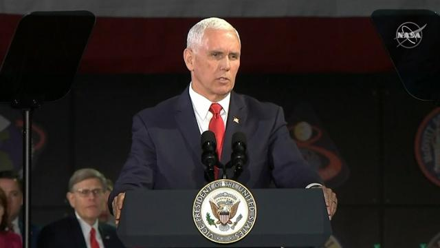 "Vice President Pence says ""But now's come the time for us to make the next giant leap and return Ame"