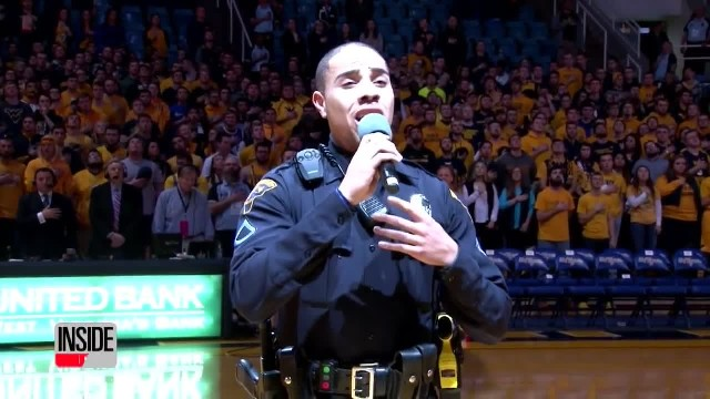 Singer no-show at game. Cop grabs mic & stuns crowd with national anthem performance